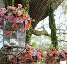 I adore this lantern idea..would be lovely for a garden party or just to have a couple on our front porch & change out the flowers.