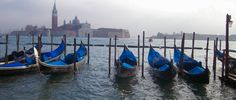 Venice Italy, gondolas are a great, but expensive way to see the city. Check out the city in a different way than on foot by winding through canals and seeing the sights from the water!