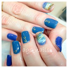 nails colour are and the index finger is done with all these colours in a swipe marble Gold triangles on the middle and ring finger Finger Nails, Ring Finger, Marbled Nails, Ocean Heart, Nail Colors, Colours, Blue Nails, Triangles, You Nailed It