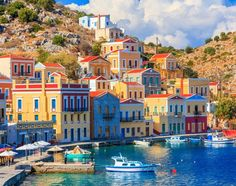 Symi, Greece is beautiful. I would love to help plan your Greek Isles trip. Stars D'hollywood, Greek Isles, Building Art, Southern Europe, Mediterranean Style, Beautiful Places To Visit, Greece Travel, Monuments, Places To Travel