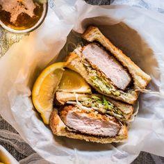 This Tonkatsu Sando features a brined and breaded pork chop topped with kewpie mayo, katsu sauce and shaved cabbage. Katsu Recipes, Tonkatsu, Best Sandwich, Hand Pies, Wrap Sandwiches, Ohana, Dumplings, Pork Chops, Japanese Food