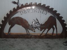 """56"""" fighting buck saw blade metal art sign.  Text can be added as this example has their name.  This is a good size for an entry sign at your driveway when set in a stand."""