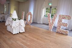 Cake table decor with flower wall light up LOVE letters Cake Table Decorations, Function Room, Greggs, Flower Wall, Light Up, Wedding Venues, Wall Lights, Letters, Elegant