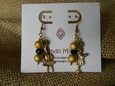 Gold Vintage Dangle Earrings with Gold and Crimson Beads and Little Girl Milagro Approximately 2.25 inches (6 centimeters) Segundo Milagro gringagordon@gmail.com http://segundomilagro.tumblr.com  #milagro #milagros #spirit #christian #catholic #religious #blessing #altars #altar #miracle #charm #charmed #blessed #divine #mexico #saints #mexican #sale #gift #custom #folk #art #handmade #artifact #faith #style #shop #protection #custom #cool #god #cross #prayer #chic #fashion #jewelry #girl