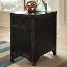 The Galveston #accent #table collection is made with select veneers and solids in a dry vintage weathered black finish.This piece has a drawer and door opening with small wrought iron looking dark bronze color accent hardware.