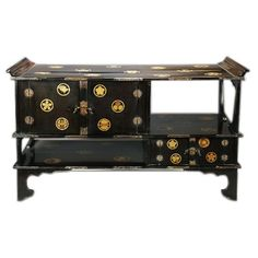 1stdibs.com | Japanese black lacquer tana (tiered tea cabinet) with gold crest