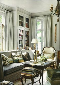 Living Room- LOVE the detail on the bottom of the sofa and the grey walls & window treatments