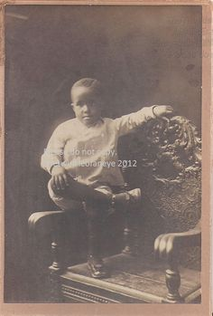 Vintage African American photograph Little by The Twinkle of An Eye, $25.00:  Cute little African American boy photograph. He poses on the arm of a chair, his leg crossed over his knee. Still in short pants, he is probably around 4 years old. I just love his little expression. A special day this was, all dressed up and his hair neatly parted. Photo is in good condition, mounted onto heavy cardboard and has wear consistent with age. Please see scan for details and contact me with any…