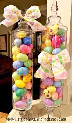 Candy jars filled with Easter eggs// I need to get some of these from hobbylobby