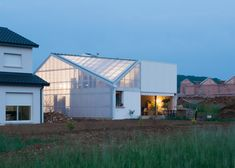 House designed by GENS as collage of banal components