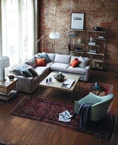 decoração sala de estar no estilo industrial com parede rústica de tijolos