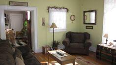 pale celery living room walls, darker furniture