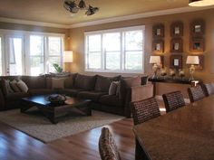 Love this living room! Paint color is called Whole Wheat by Sherwin Williams.
