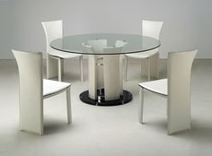 Marvellous design ideas of Dinette Table with round shape glass top and white black metal base leg also combine with white armless chairs with high backs. ➤ Discover the season's newest designs and inspirations. Visit us at www.moderndiningtables.net #diningtables #homedecorideas #diningroomideas @ModDiningTables