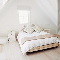 A Can't-Fail Color Scheme: All White | Read This Before You Finish Your Attic | Photos | Living Spaces | This Old House  ...light colors and similar tonal values make it seem bigger