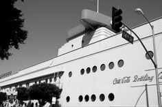 "Los Angeles Coca-Cola bottling building.     ""Robert V. Derrah's Coca-Cola Company Bottling headquarters (1936) is a stunning expression of Streamline Modern style, a later branch of the Art Deco movement, featuring curving forms, long horizontal lines, and nautical influence."""