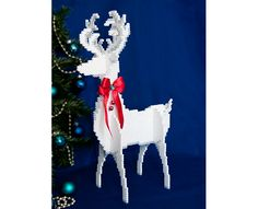 "Our handsome white reindeer stands about 15"" tall and is easy to make with Perler beads and slot-to-slot assembly. Add a bright red bow with small jingle bells around his neck for a festive look!"