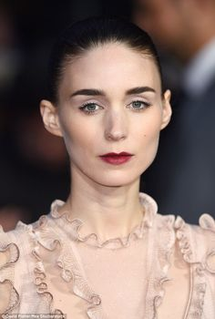Finishing touch: Rooney Mara contrasted the soft, pretty colour palette of her dress with some vampy makeup, adding a pop of colour with a deep ruby lip - October 14, 2015