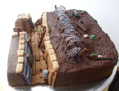 World War One Trench Birthday Cake edible World War One trench chocolate birthday cakeRaspberry jam and chocolate buttercream filling. Army Birthday Cakes, Army's Birthday, Paintball Birthday, Paintball Party, Army Cake, Military Cake, Buttercream Filling, Chocolate Buttercream, Cake Decorating Supplies