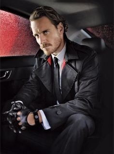 Michael Fassbender for Vanity Fair  i get why he's every woman's new crush obsession..he's kinda hunky in a dangerous way..kinda.  Michael Fassbender is the latest Irish Import, in all black, with black skinny tie, black trench coat, and black leather breaking-and-entering-oops!-i mean, black leather driving gloves. probably in the back seat of a Bentley