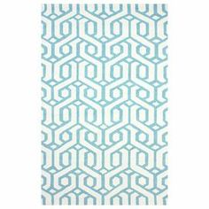 Define an area in your living room or den with this eye-catching rug, showcasing an interlocking geometric motif in blue.  Product: RugConstruction Material: 100% PolyesterColor: BlueNote: Please be aware that actual colors may vary from those shown on your screen. Accent rugs may also not show the entire pattern that the corresponding area rugs have.Cleaning and Care: Spot treat with a mild detergent and water. Professional cleaning is recommended if necessary.