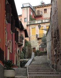 So pretty... I'm guessing this is in Italy... Old cities such as Verona or Sienna are full of beautiful streets such as this one... <3
