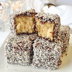 Chocolate Coconut Cake Squares a.k.a. Lamingtons, homemade white cake dipped in a decadent chocolate syrup and then rolled in coconut. An Australian fave!
