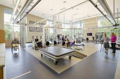 A combination of five different therapy gyms at Craig Hospital provides patients and therapists with ample space and advanced equipment to help patients regain their independence. Large expanses of windows offer views and natural light. Photo: Cooperthwaite Productions.