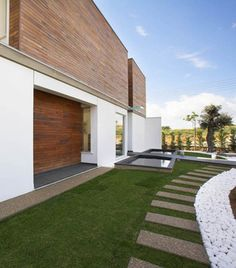 Airy Residence in Cyprus Combining Wood and Glass on a White Background
