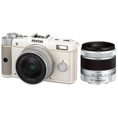 Pentax Q 12.4 MP CMOS Sensor Dual Lens Kit with 8.5mm and 5-15mm zoom (White). World's smallest and lightest interchangeable lens camera system. 12.4 MP backlit CMOS sensor with ISO from 125 to 6400. Supports 12 bit DNG, RAW and JPG files. Full 1080p HD video at 30 fps with h.264 compression. Large 3: LCD with in camera HDR mode. Sensor shift shake reduction for stalized dust free images.
