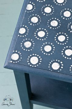 A small side table stenciled with the Circles stencil from the Annie Sloan Stencil Collection