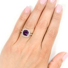 @Overstock - Click here for Ring Sizing ChartBeautifully crafted gemstone ringAmethyst surrounded by diamondshttp://www.overstock.com/Jewelry-Watches/14k-White-Gold-1-2ct-Diamond-Amethyst-Ring/2300167/product.html?CID=214117 $749.99