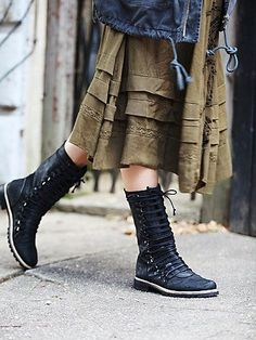 Fleet Mid Boot   Utilitarian washed leather mid boots with lace-up fronts with gusset panels underneath. Treaded rubber soles. Full zip backs. Feature Spanish craftsmanship.  *By Free People