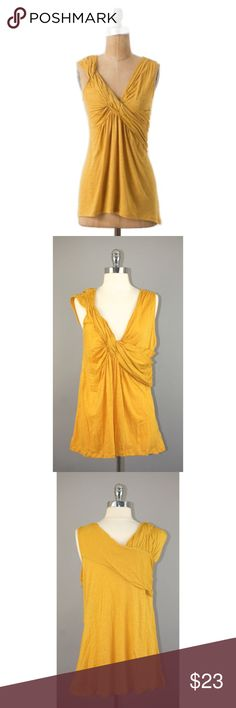 """Deletta Sz S Anthro Twist And Flounce Top NWOT 🔸Deletta Sz S Anthro Twist And Flounce Top NWOT🔸Size Small🔸Mustard/Golden color🔸Corkscrew twist front🔸Sleeveless🔸Jersey cotton material🔸Length 26""""🔸Bust 34-34- Slight stretch🔸Style No. 24614661🔸NWOT Anthropologie Tops Tank Tops"""