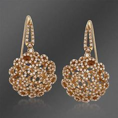 Roberto Coin earrings in diamonds and rose gold.