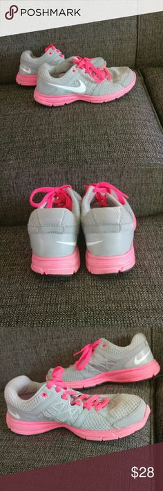 🆕 Nike Tennis Shoes Over all great condition.  Only used several time so tread wear is minimal.  Clean!  ⛔Says size 8.5 but I'm an 8 and they are slightly snug. ⛔ Gray and peachy/pink in color.⛔  11 1/4 inches from toe to heal  ⛔Please make offers thru the OFFER TAB ONLY. I DO NOT negotiate on the listing.⛔  ❌No trades ❌No modeling ❌No holds 53 Nike Shoes Sneakers