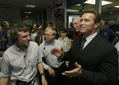 California Gov. Arnold Schwarzenegger cheers with Dr. Steve Squyres, principal investigator for Opportunity, and other Mars rovers team members in the Mission Control Center at NASA's JPL in Pasadena, California, on January 24, 2004., following the safe landing of the Opportunity rover on Mars. (AP Photo/Damian Dovarganes/Pool) #