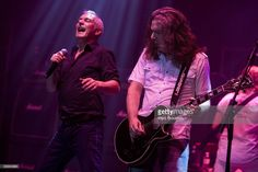 Danny Bowes and Ben Matthews of the band Thunder perform on stage at Hammersmith Apollo on July 11, 2009 in London, England.