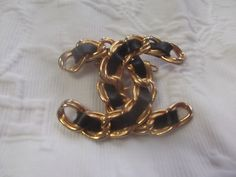 Vintage Chanel Interlaced Black Leather Broach Pin