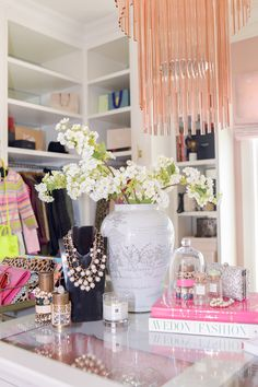 Boutique style fashion books pink jewelry flowers elegant pearls classy shop vase store boutique