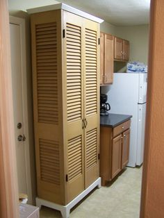 Repurposed Bifolding Doors. Using this idea to create a door for hot water heater cabinet.