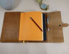 A5 Light Brown Leather Notebook Cover, fits notebook and journal...Excellent fit for Moleskine, Leuchtturm, and Rhodia.  Pen holder.