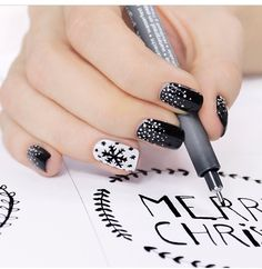 Snowflake black & white nail design