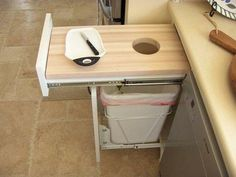 drawer that is a pull out cutting board above trashcan. Clever.