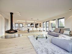 Penthouse: Modern Wohnzimmer von honey and spice