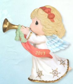 Precious Moments 2013 Dated Figurine Peace On Earth and Goodwill to All  From the Annual Precious Moments Dated Christmas Collection. We invite you to Commemorate the 2013 Christmas Season with the Precious Moments Annual 2013 Dated Christmas Figurine titled: Peace On Earth and Goodwill to All. This year's annual figurine features an angel blowing a trumpet. A 2013 ribbon is featured on the side. This figurine is made of porcelain. $35.00 #PreciousMoments #Christmas