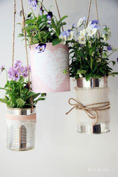 Just Soup-er – Chances are your recycling bin is always filled with cans — pluck a few out, clean them up and create a hanging display for the porch. Click for the full tutorial and for more diy planters.
