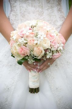White rose bridal bouquet with a hint of color.