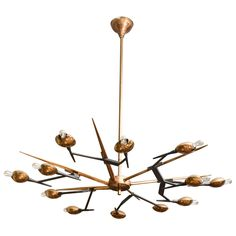 1960's Italian brass and black metal chandelier by Oscar Torlasco