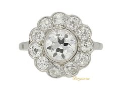 Diamond cluster halo bezel engagement ring, French, circa 1920 | Berganza
